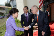 South Korean President Park Geun-hye (L) is greeted by California Governor Jerry Brown (R) and Los Angeles Mayor Antonio Villaraigosa as she arrives for a welcoming luncheon at Getty House on May 9, 2013 in Los Angeles, California. Park will visit Korean business leaders in Los Angeles today as she continues a five-day, unity-building visit to the United States. Park has been in the United States since Monday, when she visited the United Nations. She met with President Barack Obama Tuesday and addressed a joint session of Congress Wednesday.