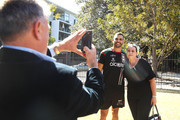 Greg Inglis poses with a supporter before speaking to the press during a South Sydney Rabbitohs NRL media opportunity at Redfern Oval on September 18, 2018 in Sydney, Australia.