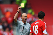 Jack Cork of Southampton is booked by match referee Mike Dean during the Barclays Premier League match between Southampton and Manchester United at St Mary's Stadium on May 11, 2014 in Southampton, England.