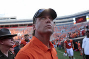 Head Coach of the Oklahoma State Cowboys Mike Gundy looks across the stadium after the game against the Southeastern Louisiana Lions September 3, 2016 at Boone Pickens Stadium in Stillwater, Oklahoma. The Cowboys defeated the Lions 61-7.