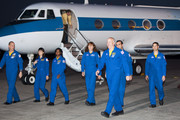 NASA's STS-131 astronauts, Pilot James P. Dutton Jr., mission specialist Rick Mastracchio, commander Alan Poindexter, mission specialists Dorothy Metcalf-Lindenburger, Stephanie Wilson, Japan Aerospace Exploration Agency astronaut Naoko Yamazaki and NASA astronaut Clayton Anderson prepare to address the media after arriving in a Gulfstream jet at the shuttle landing facility at Kennedy Space Center March 5, 2010, in Cape Canaveral. The astronauts arrived to prepare for their upcoming launch aboard Space Shuttle Discovery, scheduled for April 5.