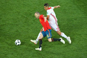 Andres Iniesta of Spain is challenged by Faycal Fajr of Morocco during the 2018 FIFA World Cup Russia group B match between Spain and Morocco at Kaliningrad Stadium on June 25, 2018 in Kaliningrad, Russia.
