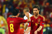 Xabi Alonso of Spain celebrates after scoring the first goal with Xavi during the UEFA EURO 2012 quarter final match between Spain and France at Donbass Arena on June 23, 2012 in Donetsk, Ukraine.