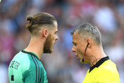 David De Gea of Spain argues with referee Bjorn Kuipers after he awards Russia with a penalty during the 2018 FIFA World Cup Russia Round of 16 match between Spain and Russia at Luzhniki Stadium on July 1, 2018 in Moscow, Russia.