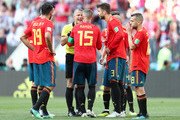 Gerard Pique of Spain  of Spain argue with referee Bjorn Kuipers after he awards Russia with a penalty during the 2018 FIFA World Cup Russia Round of 16 match between Spain and Russia at Luzhniki Stadium on July 1, 2018 in Moscow, Russia.