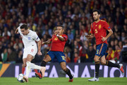 Harry Winks of England duels for the ball with Thiago Alcantara of Spain during the UEFA Nations League A Group Four match between Spain and England at Estadio Benito Villamarin on October 15, 2018 in Seville, Spain.
