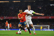 Thiago Alcantara of Spain shields the ball from Harry Kane of England during the UEFA Nations League A Group Four match between Spain and England at Estadio Benito Villamarin on October 15, 2018 in Seville, Spain.