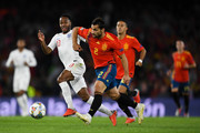 Raheem Sterling of England battles for the ball with Jonny of Spain during the UEFA Nations League A group four match between Spain and England at Estadio Benito Villamarin on October 15, 2018 in Seville, Spain.