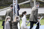 King Felipe and Queen Letizia of Spain step onto the stage with their daughters Princess Leonor (L) and Princess Sofia during their visit to Somao, which has been honoured as the 2020 Best Asturian Village, the day after the 'Princesa de Asturias' Awards on October 17, 2020 in Somao, Spain.