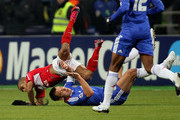 Welliton (Top) of FC Spartak Moscow battles for the ball with John Terry of Chelsea  during the UEFA Champions League Group F match between FC Spartak Moscow and Chelsea  at the Luzhniki Stadium on October 19, 2010 in Moscow, Russia.
