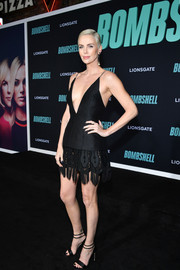 Charlize Theron complemented her dress with strappy black heels.