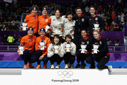 Silver medalists Marrit Leenstra, Lotte Van Beek, Ireen Wust and Antoinette De Jong of the Netherlands, gold medalists Miho Takagi, Ayaka Kikuchi, Ayano Sato and Nana Takagi of Japan and bronze medalists Heather Bergsma, Brittany Bowe, Mia Manganello and Carlijn Schoutens of the United States celebrate during the victory ceremony after the Speed Skating Ladies' Team Pursuit finals on day 12 of the PyeongChang 2018 Winter Olympic Games at Gangneung Oval on February 21, 2018 in Gangneung, South Korea.