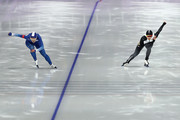 Arisa Go of Japan and Sang-Hwa Lee of Korea compete during the Ladies' 500m Individual Speed Skating Final on day nine of the PyeongChang 2018 Winter Olympic Games at Gangneung Oval on February 18, 2018 in Gangneung, South Korea.