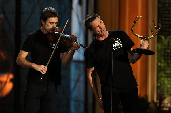 "(L-R) Actor Jim Carrey, with violinist Neil Hammond, accepts the Funniest M.F. award onstage during Spike TV's 5th annual 2011 ""Guys Choice"" Awards at Sony Pictures Studios on June 4, 2011 in Culver City, California."