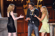 She accepts horned awards from Kristen Bell and Dax Shepard. - Emma Stone's Celebrity Friends