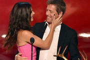 "Actress Sandra Bullock accepts the Decade of Hotness award from actor Hugh Grant onstage during Spike TV's ""Guys Choice 2014"" at Sony Pictures Studios on June 7, 2014 in Culver City, California."
