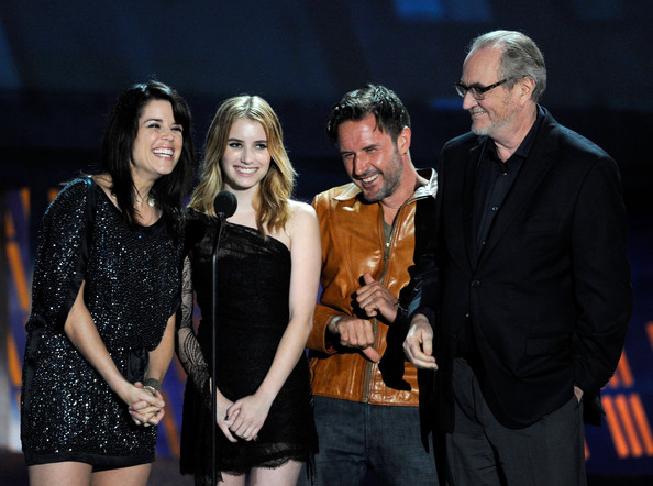 "(L-R) Actors Neve Campbell, Emma Roberts, director Wes Craven, and actor David Arquette speak onstage during Spike TV's ""Scream 2010"" at The Greek Theatre on October 16, 2010 in Los Angeles, California."