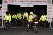 The Sport Relief Million Pound Bike Ride Team comprising of Fearne Cotton, Miranda Hart, Russell Howard, Patrick Kielty, Davina McCall and David Walliams crosses the finish line at Lands End on March 4, 2010 in Land's End, England.