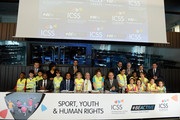 Jean-Claude Mbvoumin (L), President of Foot-Solidaire, Christian Karembeu (2L), football Legend and UEFA Global Ambassador, Emanuel Macedo de Medeiros (C), CEO, ICSS Europe and Latin America, and Pascal Reyntjens (R), Chief of Mission, International Organisation for Migration (IOM) pose with children at the Sport, Youth & Human Rights Conference Hosted by Intenational Center For Sport Security (ICSS) during the EU Week Of Sport on September 8, 2015 in Brussels, Belgium.