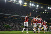 Danny Welbeck of Arsenal FC celebrates with his team mates after scoring his team's first goalduring the UEFA Europa League Group E match between Sporting CP and Arsenal at Estadio Jose Alvalade on October 25, 2018 in Lisbon, Portugal.