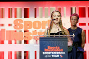 2019 Sports Illustrated Kids SportsKid of the Year Ally Sentnor speaks onstage with Megan Rapinoe during the Sports Illustrated Sportsperson Of The Year 2019 at The Ziegfeld Ballroom on December 09, 2019 in New York City.