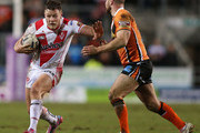 Josh Jones of St Helens in action with Liam Finn of Castleford Tigers during the First Utility Super League match between St Helens and Castleford Tigers at Langtree Park on February 27, 2015 in St Helens, England.