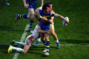 Shannon McDonnell (L) and Matt Fleming of  St Helens taclkles Stefan Ratchford of  Warrington Wolves during the Super League match between St Helens and   Warrington Wolves at St James' Park on May 31, 2015 in Newcastle upon Tyne, England.
