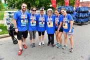Participants Denise Drucker, Dena Mannos, Katy Drucker, Megan Xidas, Amy Drucker and Tim Kelly celebrate after they cross the finish line during the St. Jude Rock 'n' Roll Nashville Marathon on April 29, 2017 in Nashville, Tennessee.  (Photo by Jason Davis/Getty Images for St. Jude