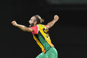 In this handout image provided by CPL T20, Imran Tahir of Guyana Amazon Warriors celebrates during match 19 of the Hero Caribbean Premier League between St Kitts & Nevis Patriots and Guyana Amazon Warriors at the Warner Park Sporting Complex on August 25, 2018 in Basseterre, St Kitts, Saint Kitts And Nevis.