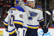 Brayden Schenn #10 of the St. Louis Blues congratulates Carter Hutton #40 after a win over the Chicago Blackhawks at the United Center on April 6, 2018 in Chicago, Illinois. The Blues defeated the Blackhawks 4-1.