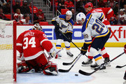 Vladimir Tarasenko #91 of the St. Louis Blues watches his pass go by the stick of Alexander Steen #20 and Petr Mrazek #34 of the Detroit Red Wings during the third period at Little Caesars Arena on December 9, 2017 in Detroit, Michigan. St. Louis won the game 6-1.