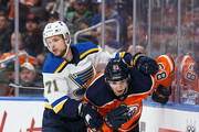 Matthew Benning #83 of the Edmonton Oilers battles against Vladimir Sobotka #71 of the St. Louis Blues at Rogers Place on December 21, 2017 in Edmonton, Canada.