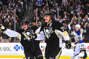 Evgeni Malkin #71 and David Perron #57 of the Pittsburgh Penguins celebrate a goal against the St. Louis Blues during the game at Consol Energy Center on November 25, 2015 in Pittsburgh, Pennsylvania.