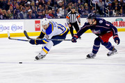 Zach Werenski #8 of the Columbus Blue Jackets attempts to steal the puck from Brayden Schenn #10 of the St. Louis Blues during the third period on March 24, 2018 at Nationwide Arena in Columbus, Ohio. St. Louis defeated Columbus 2-1.