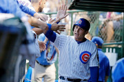 Anthony Rizzo #44 of the Chicago Cubs is congratulated in the dugout after scoring against the St. Louis Cardinals on an RBI single hit by Jason Heyward #22 (not pictured) during the fifth inning at Wrigley Field on July 19, 2018 in Chicago, Illinois.