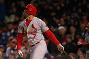 Matt Holliday #7 of the St. Louis Cardinals hits a run-scoring single in the fifth ining against the Chicago Cubs during the Opening Night game at Wrigley Field on April 5, 2015 in Chicago, Illinois.