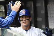 Anthony Rizzo #44 of the Chicago Cubs is greeted in the dugout after hitting a an RBI sacrifice fly ball against the St. Louis Cardinals during the fifth inning on September 28, 2018 at Wrigley Field  in Chicago, Illinois.