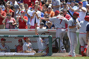 Fans cheer as Matt Holliday #7 of the St. Louis Cardinals is greeted at the dugout after hitting a solo home run during the first inning against the Chicago Cubs at Wrigley Field on July 27, 2014 in Chicago, Illinois. The Cardinals defeated the Cubs 1-0.