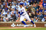 Anthony Rizzo #44 of the Chicago Cubs hits an RBI double in the third inning against the St. Louis Cardinals at Wrigley Field on September 30, 2018 in Chicago, Illinois.