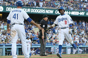 Dee Gordon #9 and Chris Robinson #41 of the Los Angeles Dodgers celebrate after both score on a Juan Uribe two run single in the eighth inning against the St. Louis Cardinals at Dodger Stadium on June 28, 2014 in Los Angeles, California. The Dodgers won 9-1.