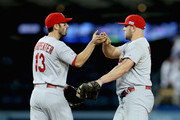 Matt Holliday #7 and Matt Carpenter #13 of the St. Louis Cardinals celebrate thei 10-9 win over the Los Angeles Dodgers in Game One of the National League Division Series at Dodger Stadium on October 3, 2014 in Los Angeles, California.