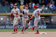 Greg Garcia #35, Harrison Bader #48, and Kolten Wong #16 of the St. Louis Cardinals celebrate after beating the Milwaukee Brewers 8-2 at Miller Park on June 24, 2018 in Milwaukee, Wisconsin.