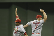 Matt Holliday #7 of the St. Louis Cardinals and Jon Jay #19 celebrate after the 7-6 win over the Milwaukee Brewers at Miller Park on July 11, 2014 in Milwaukee, Wisconsin.