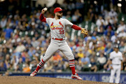 Greg Garcia #35 of the St. Louis Cardinals pitches in the eighth inning against the Milwaukee Brewers at Miller Park on June 21, 2018 in Milwaukee, Wisconsin.
