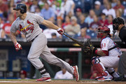 Left fielder Matt Holliday #7 of the St. Louis Cardinals hits a two RBI double in the top of the first inning against the Philadelphia Phillies on August 22, 2014 at Citizens Bank Park in Philadelphia, Pennsylvania.
