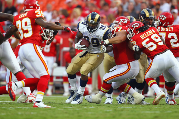 Steven Jackson powers through a line of Chiefs. Photo by Dilip Vishwanat/Getty Images