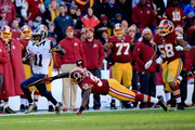 Wide receiver Tavon Austin #11 of the St. Louis Rams avoids the tackle by running back Silas Redd #32 of the Washington Redskins as he scores a third quarter punt return touchdown at FedExField on December 7, 2014 in Landover, Maryland.