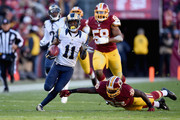 Wide receiver Tavon Austin #11 of the St. Louis Rams avoids the tackle of running back Silas Redd #32 of the Washington Redskins as he scores a third quarter punt return touchdown at FedExField on December 7, 2014 in Landover, Maryland.