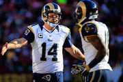Quarterback Shaun Hill #14 of the St. Louis Rams celebrates with Tavon Austin #14 after the Rams scored a first half touchdown against the Washington Redskins at FedExField on December 7, 2014 in Landover, Maryland. The Rams won 24-0.