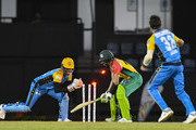 In this handout image provided by CPL T20, Shoaib Malik (C) of Guyana Amazon Warriors dismiss by Andre Fletcher (L) of St Lucia Stars during match 15 of the Hero Caribbean Premier League between St Lucia Stars and Guyana Amazon Warriors at the Darren Sammy Cricket Ground on August 24, 2018 in Gros Islet, Saint Lucia.